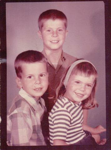 My brothers and me: I had received a beating right before this picture because I cut my bangs