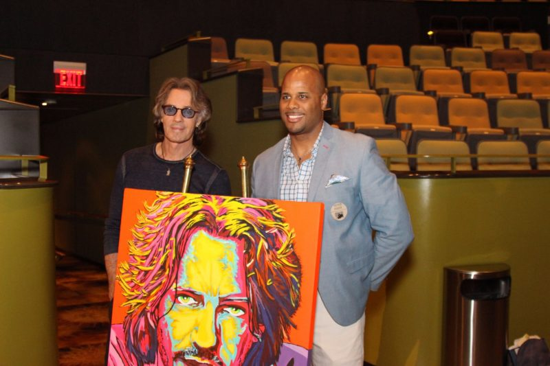 Rick with artist Mike Emory who created the fabulous art piece of Rick seen here